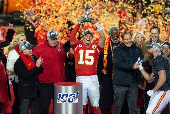 Kansas City Chiefs quarterback Patrick Mahomes hoists the Lamar Hunt AFC Championship trophy over his head