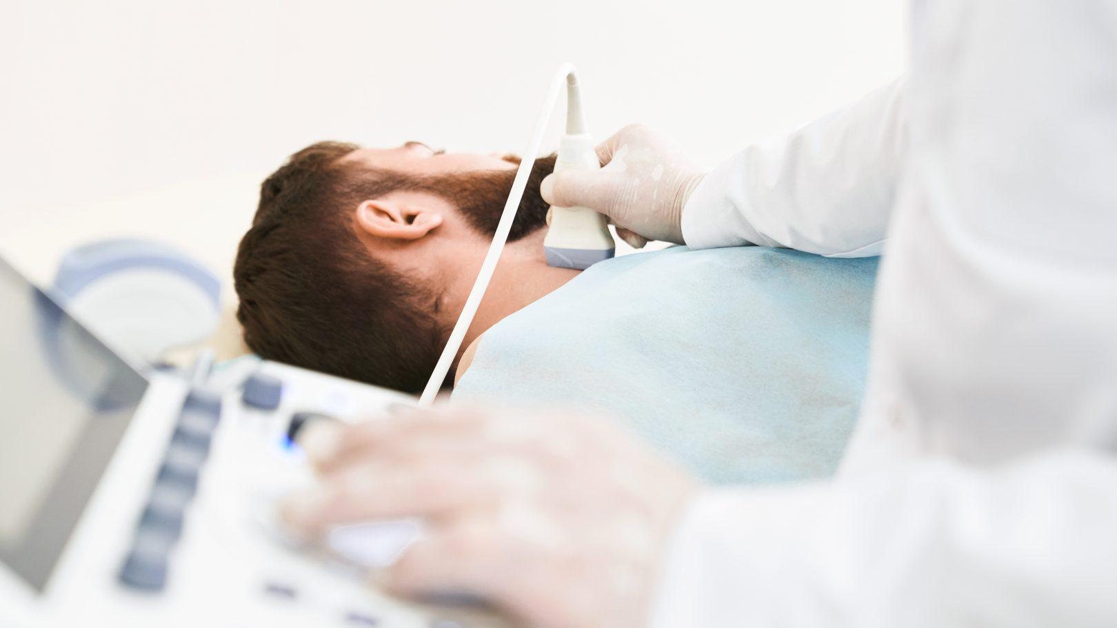 A doctor checks a patient's lymph nodes