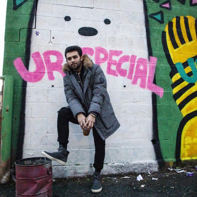 danny casale in front of mural