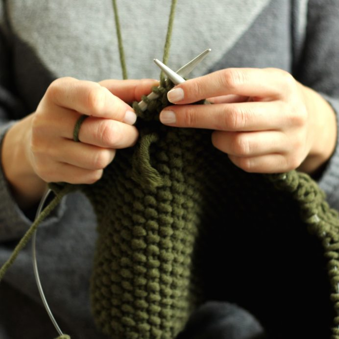 Close-Up Of Woman Hands Knitting