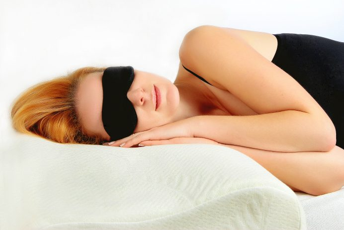 Woman sleeping in sleeping eye mask