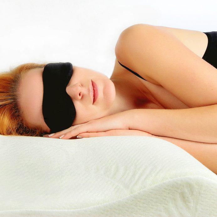 Woman sleeping in sleeping eye mask