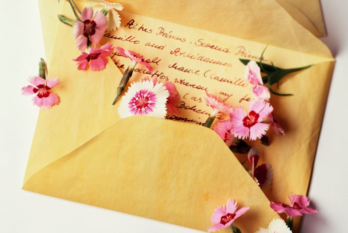Love letter with flowers (Getty Creative)