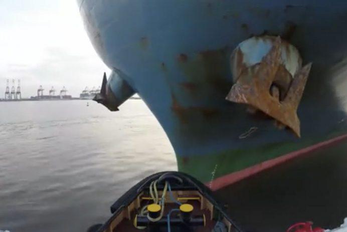 Tugboat pulling a ship