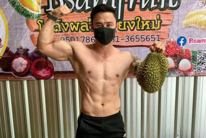 muscular men sell durian