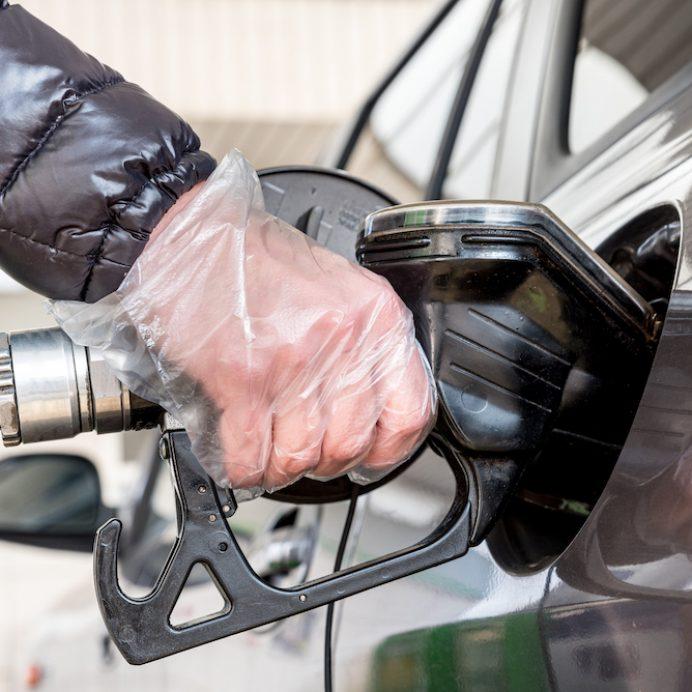 Woman refueling car