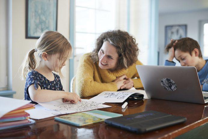 Mother homeschooling children