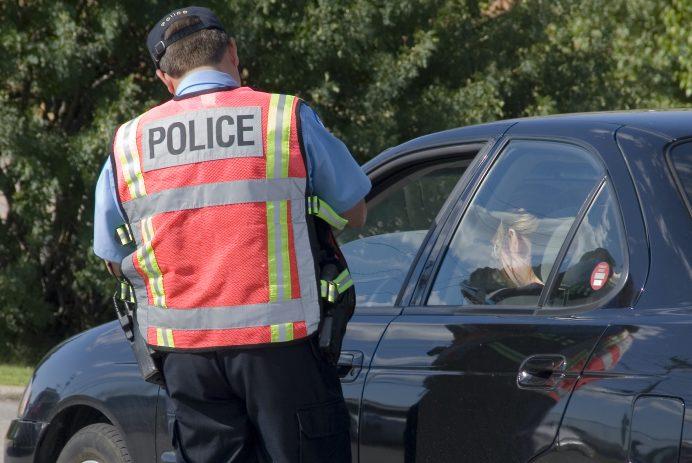 policeman writing ticket