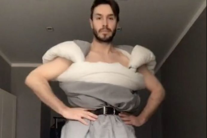 man puts on fashion show in bedroom