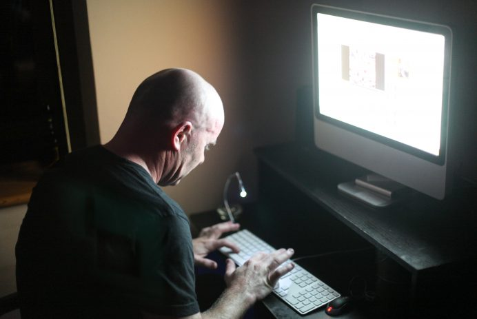 bald man typing
