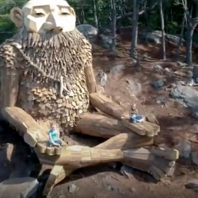 Artist builds giants from scrap wood