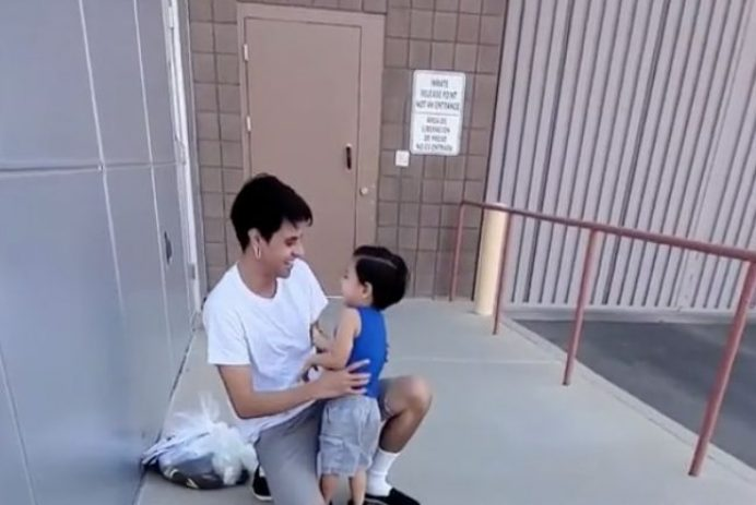 Father greets son after being released from detention center