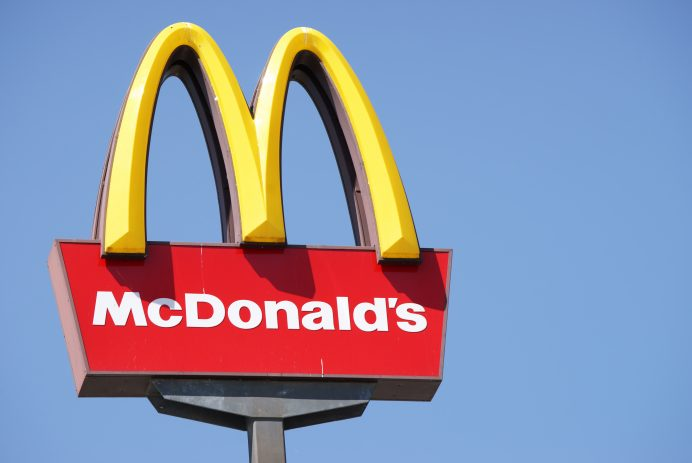 Close-up McDonalds outdoor sign against blue sky