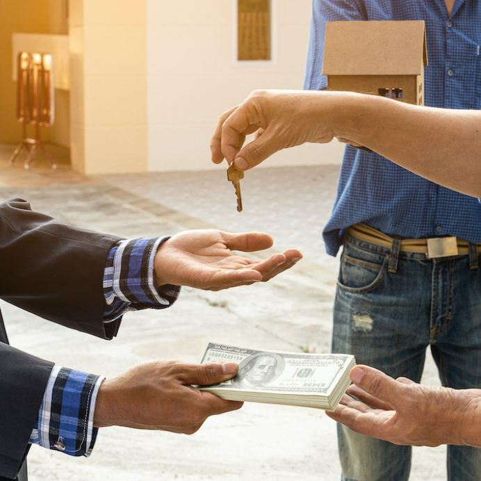 A businessman who is buying and selling a home and agrees to sell the name