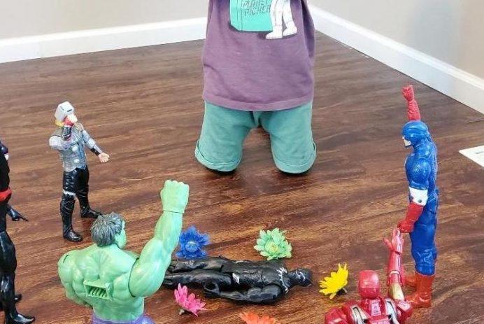 A child pays tribute to Chadwick Boseman