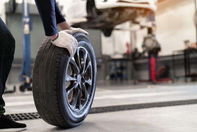 Mechanic changes tire
