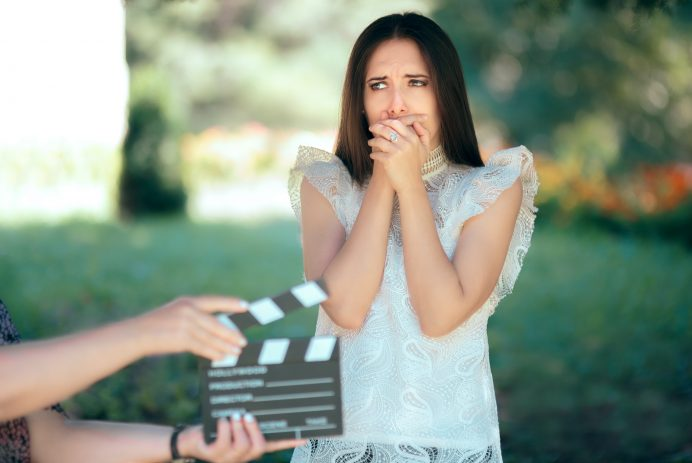 actress sad and scared in front of the camera