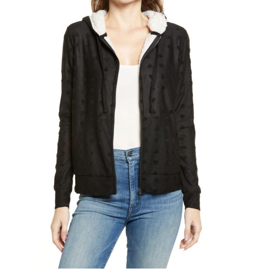a woman is wearing a fuzzy jacket