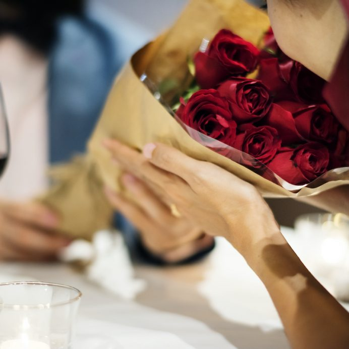Man giving red rose bouquet