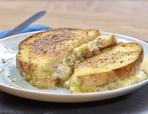 Make the best grilled cheese sandwich with 3 types of cheese, fresh herbs and 1 secret ingredient