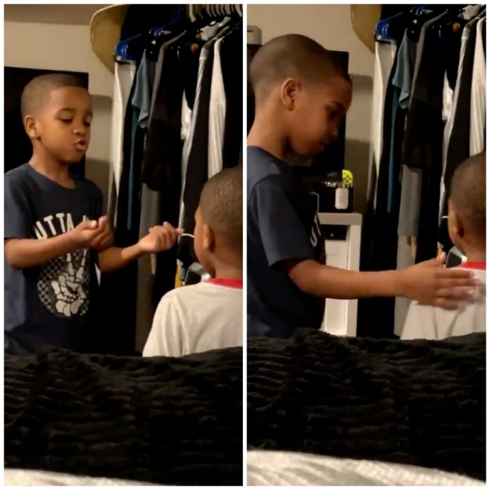 boy helping younger brother calm down breathing