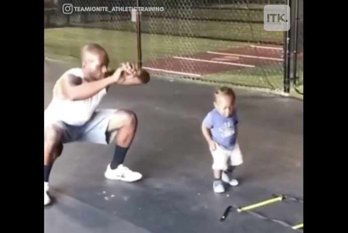 adorable toddler working out with dad