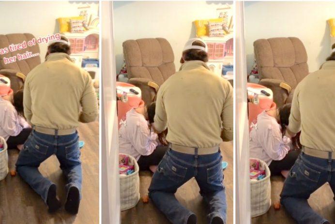 dad blow dries daughters hair